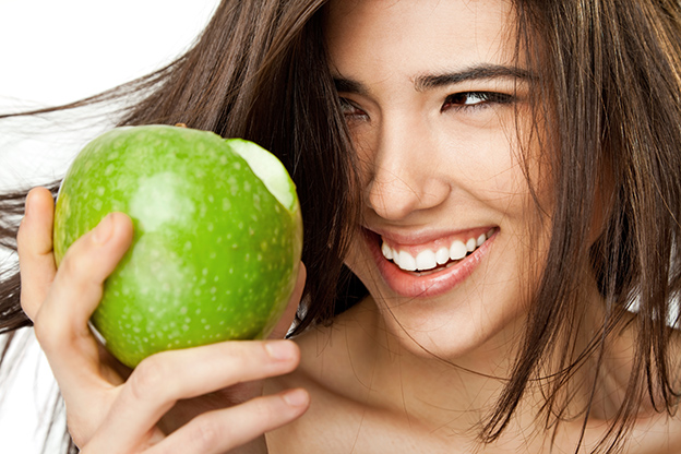 smiling female face apple